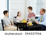 family of four talking by table ...   Shutterstock . vector #594537956