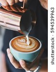 how to make coffee latte art | Shutterstock . vector #594539963