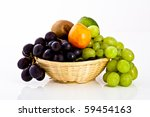 isolated fruits mix in a braided dish - stock photo