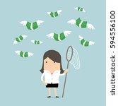 businesswoman catch flying... | Shutterstock .eps vector #594556100