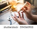 close up of asian woman hands... | Shutterstock . vector #594560903