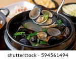 jogae tang is  scallop  clam  ... | Shutterstock . vector #594561494
