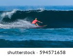 riding the waves. costa rica ... | Shutterstock . vector #594571658
