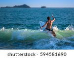 riding the waves. costa rica ... | Shutterstock . vector #594581690