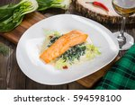 salmon fish steak served with... | Shutterstock . vector #594598100