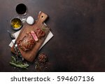 grilled ribeye beef steak with... | Shutterstock . vector #594607136