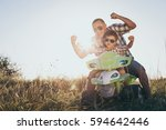 father and son playing on the... | Shutterstock . vector #594642446
