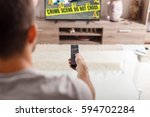 man with remote control... | Shutterstock . vector #594702284