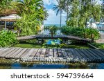 view in tropical beach resort ... | Shutterstock . vector #594739664
