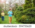 kids on easter egg hunt in... | Shutterstock . vector #594753620