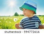 happy baby boy standing in... | Shutterstock . vector #594772616