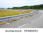 Highway Passing Through The Countryside With Crash Barrier - stock photo