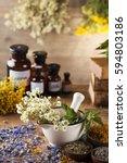 natural medicine on wooden... | Shutterstock . vector #594803186