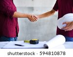 Small photo of handshake in order to settle an agreement, establishing trustworthiness, allegiance, and potency in business cooperation.