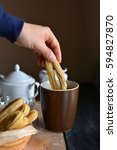 Small photo of Churros accompanied of a cup of chocolate hot and sugar