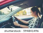 young woman happy in car | Shutterstock . vector #594841496