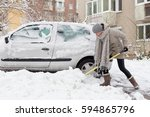 independent woman shoveling her ... | Shutterstock . vector #594865796
