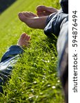 Small photo of Couple lying in grass. Absolute relaxation.