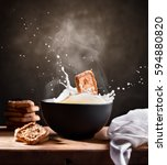 cookie falling into a steaming... | Shutterstock . vector #594880820
