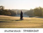 golf player goes over golf... | Shutterstock . vector #594884369