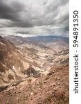 peruvian andes canyon and roads ... | Shutterstock . vector #594891350