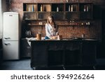 a girl in the kitchen sprinkles ... | Shutterstock . vector #594926264