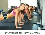 sporty people doing plank... | Shutterstock . vector #594927983