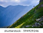 tourist on the top of the hill... | Shutterstock . vector #594929246