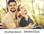 young couple is enjoying spring ... | Shutterstock . vector #594947024