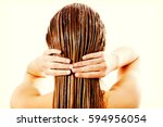 woman applying hair conditioner.... | Shutterstock . vector #594956054
