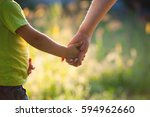 mother and son holding hand in... | Shutterstock . vector #594962660