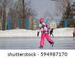 little adorable girl on ice... | Shutterstock . vector #594987170