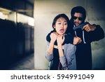 man in hoodie robbing and...   Shutterstock . vector #594991049