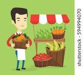 asian greengrocer standing near ... | Shutterstock .eps vector #594994070
