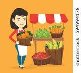 asian greengrocer standing near ... | Shutterstock .eps vector #594994178