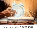 Small photo of Business man using laptop computer. Work against time