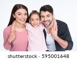 happy young family with one... | Shutterstock . vector #595001648