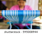 woman weaving traditional... | Shutterstock . vector #595008944