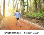 athletic young man running in... | Shutterstock . vector #595042634