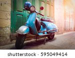 vintage scooter stands in an... | Shutterstock . vector #595049414