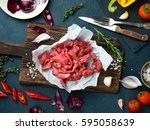 fresh raw chopped beef on a... | Shutterstock . vector #595058639