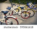 rows of bicycles are placed on... | Shutterstock . vector #595061618
