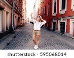 happy young female traveler... | Shutterstock . vector #595068014