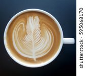 top view of a mug of latte art...   Shutterstock . vector #595068170