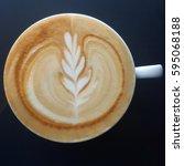 top view of a mug of latte art...   Shutterstock . vector #595068188