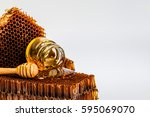 drop of brown honey on a wooden ... | Shutterstock . vector #595069070