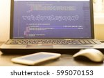 Small photo of Web development phrase ASCII art inside HTML code. Web developer workplace in sunset lights. Abstract information technology background. Laptop and mouse on keyboard.