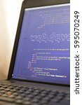 Small photo of Web development phrase ASCII art inside HTML code close up. Web developing concept on screen. Abstract information technology modern background. Laptop in sunset lights. Code is created by myself.