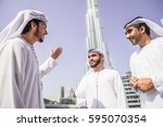 three arabic men bonding... | Shutterstock . vector #595070354