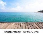 wooden bridge over blue sea and ...   Shutterstock . vector #595077698